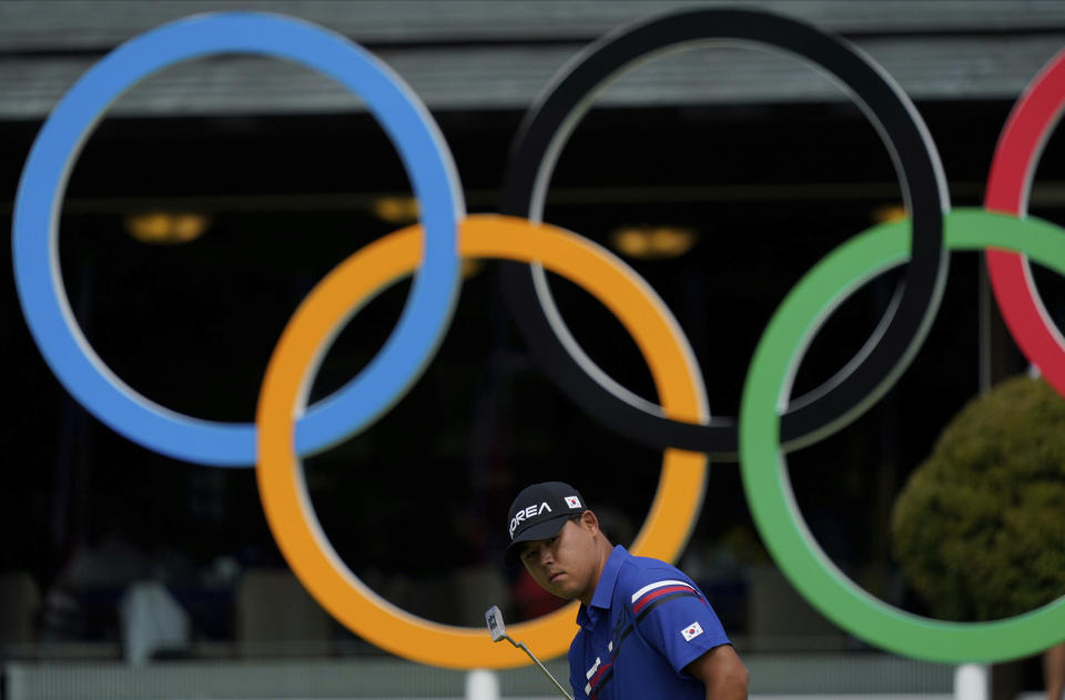 Korea's Si Woo Kim follows his putt during a practice session of the men's golf event at the 2020 Summer Olympics, Tuesday, July 27, 2021, at the Kasumigaseki Country Club in Kawagoe, Japan, (AP Photo/Matt York)