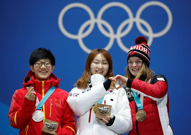 Medals Ceremony - Short Track Speed Skating Events - Pyeongchang 2018 Winter Olympics - Women's 1500m - Medals Plaza - Pyeongchang, South Korea - February 18, 2018 - Gold medalist Choi Min-jeong of South Korea, silver medalist Li Jinyu of China and bronze medallist Kim Boutin of Canada on the podium. REUTERS/Kim Hong-Ji TPX IMAGES OF THE DAY