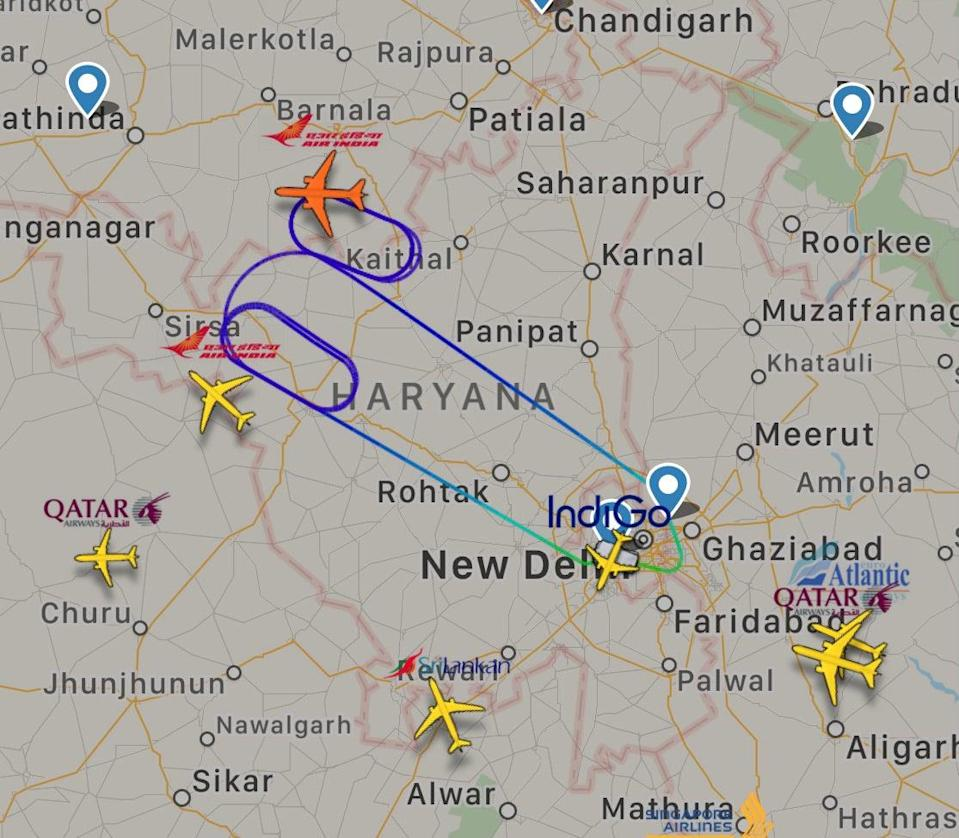 Air India Flight 105 circling near Delhi before returning to land there after a bat was spotted onboard (FlightRadar24)