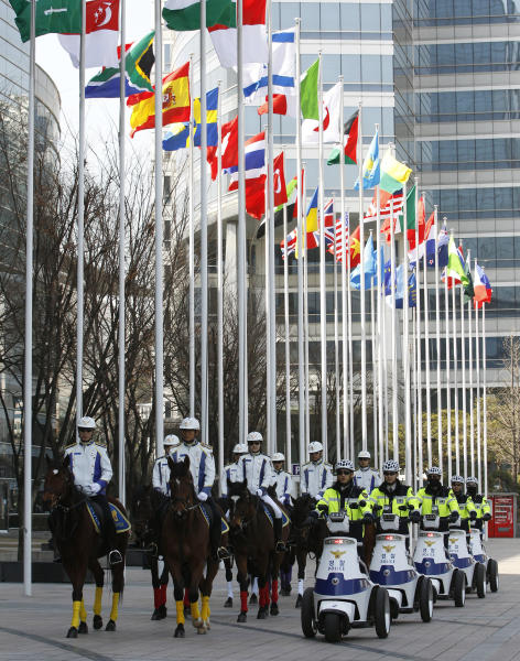 South Korean mounted police officers patrol near the venue for the Nuclear Security Summit in Seoul, South Korea, Wednesday, March 21, 2012. The summit will be held in Seoul from March 26 to 27. (AP Photo/Lee Jin-man)