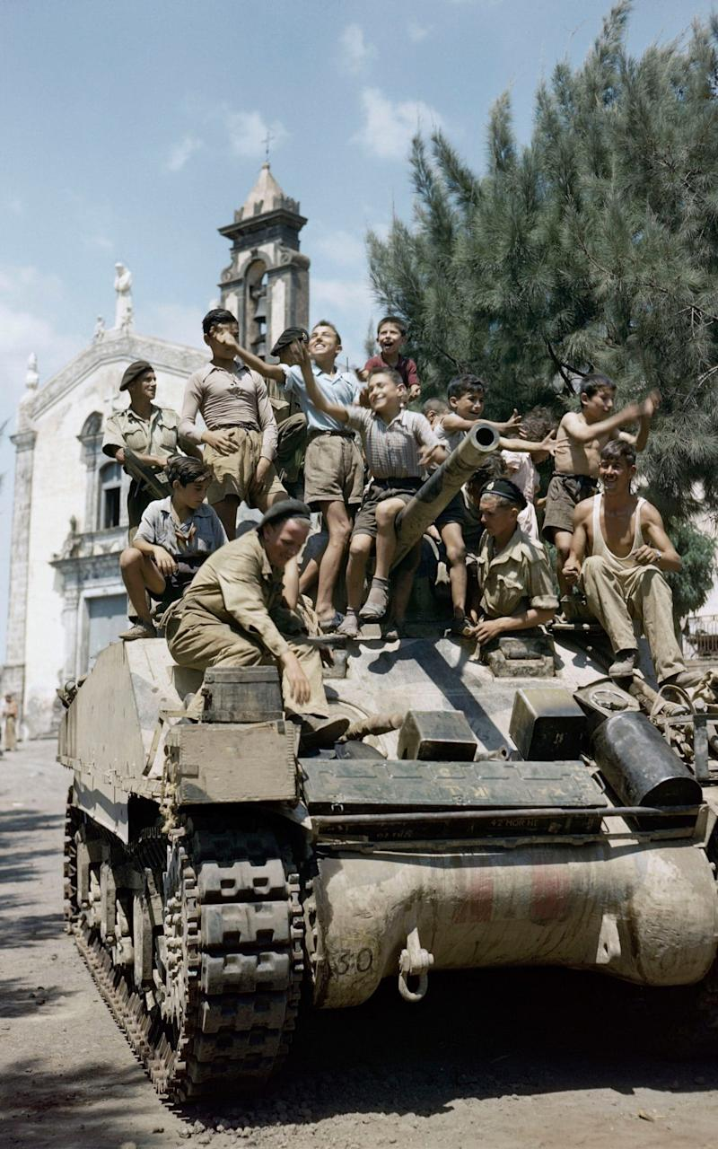 British soldiers on an American-built Sherman tank in Sicily - Credit: Imperial War Museum