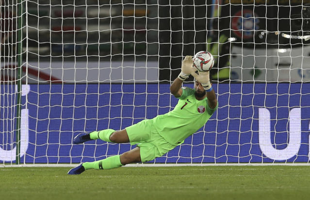 Qatar's goalkeeper Saad Al Sheeb, saves the ball during the AFC Asian Cup quarterfinal soccer match between Korea Republic and Qatar at the Zayed Sport City Stadium in Abu Dhabi, United Arab Emirates, Friday, Jan. 25, 2019. (AP Photo/Kamran Jebreili)