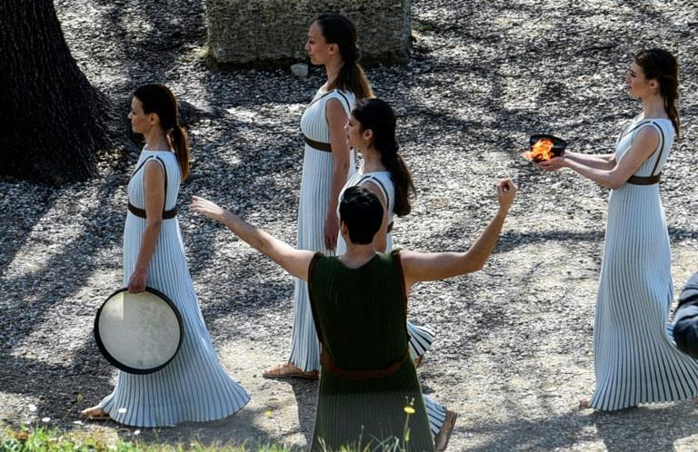 Greek actress Xanthi Georgiou holds the Olympic flame at the Temple of Hera during a dress rehearsal on March 11, 2020