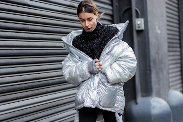 <p>If you're going to get one puffer coat this year, get a metallic silver one, especially if you enjoy wearing all black in everything else. Wear it low on your shoulders, in a style popularized by Balenciaga. (Photo: Getty) </p>