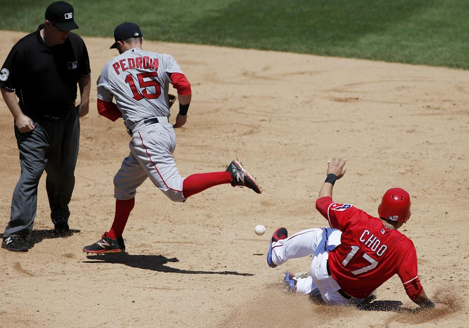 Second base umpire Todd Tichenor, left, looks on as Boston Red Sox second baseman Dustin Pedroia (15) is unable to hold onto the ball as Texas Rangers' Shin-Soo Choo (17) slides into second during the third inning of a baseball game, Sunday, May 31, 2015, in Arlington, Texas. (AP Photo/Brandon Wade)