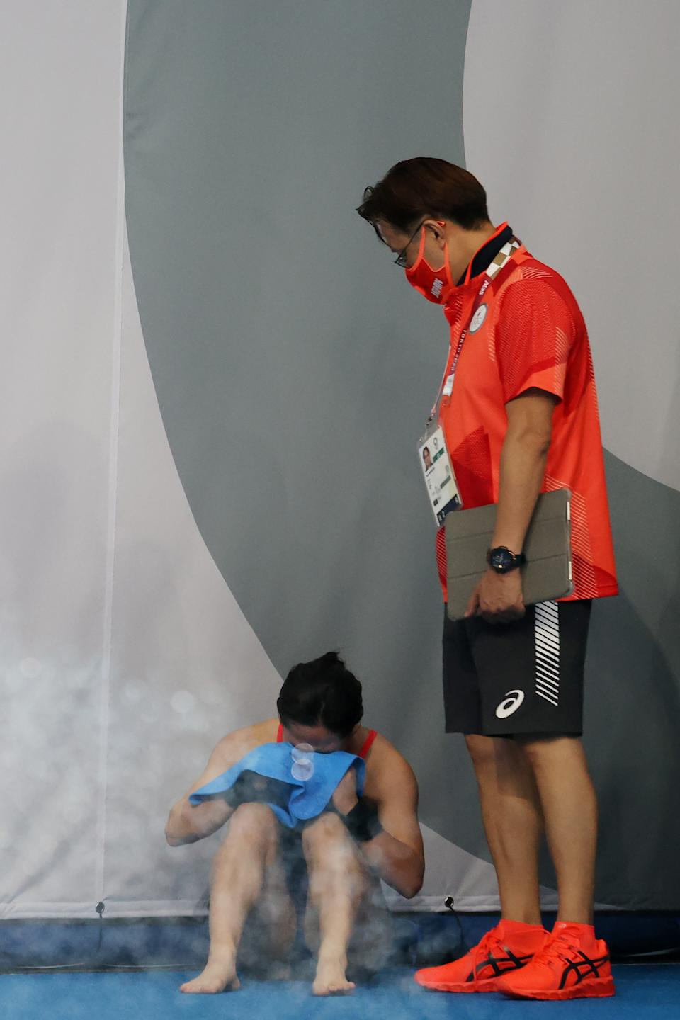 TOKYO, JAPAN - JULY 27: Minami Itahashi of Team Japan reacts after her final dive during the Women's Synchronised 10m Platform Final on day four of the Tokyo 2020 Olympic Games at Tokyo Aquatics Centre on July 27, 2021 in Tokyo, Japan. (Photo by Al Bello/Getty Images)