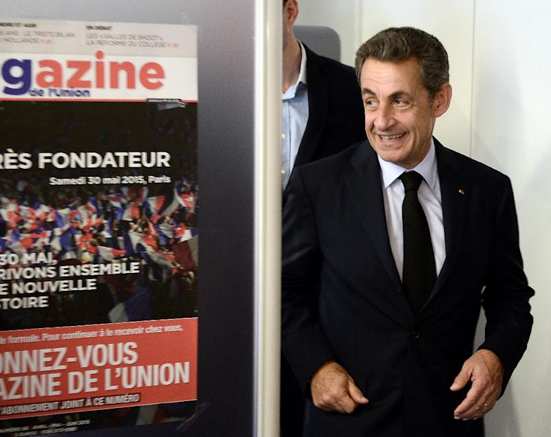 The President of the French right-wing UMP party, Nicolas Sarkozy, leaves after voting at the party's headquarters in Paris on May 28, 2015