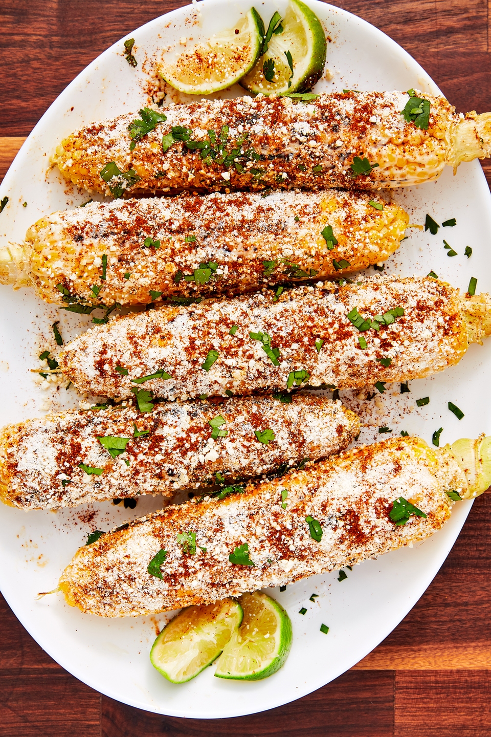 """<p>Meet your new favorite way to eat corn: Roasted over an open grill, then slathered with cojita cheese, chili powder, lime juice, and mayonnaise.</p><p><em><a href=""""https://www.delish.com/cooking/recipe-ideas/recipes/a47269/mexican-street-corn-elote-recipe/"""" rel=""""nofollow noopener"""" target=""""_blank"""" data-ylk=""""slk:Get the recipe from Delish »"""" class=""""link rapid-noclick-resp"""">Get the recipe from Delish »</a></em></p>"""