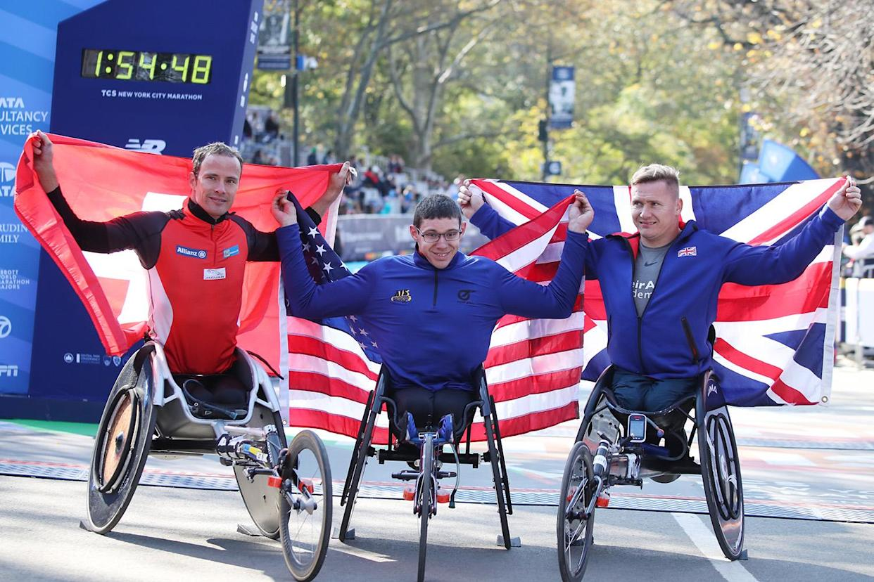 Second place finishr Marcel Hug, first place winner Daniel Romanchuk and third place finiher David Weir celebrate after the New York City Marathon wheelchair races. (Photo: PhotoRun/New York Road Runners via Getty Images)