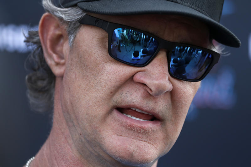 Miami Marlins manager Don Mattingly speaks to the media before the start of spring training baseball practice Wednesday, Feb. 12, 2020, in Jupiter, Fla. (AP Photo/Jeff Roberson)