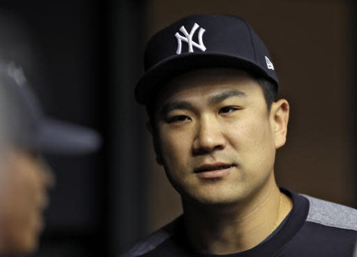 New York Yankees starting pitcher Masahiro Tanaka, of Japan, talks to teammates in the dugout during the first inning of a baseball game against the Tampa Bay Rays, Saturday, June 23, 2018, in St. Petersburg, Fla. (AP Photo/Chris O'Meara)