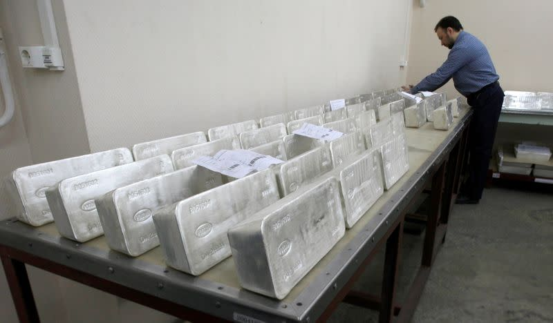 FILE PHOTO: A worker stores ingots of 99.99 percent pure silver to pack them at the Krastsvetmet nonferrous metals plant in Russia's Siberian city of Krasnoyarsk