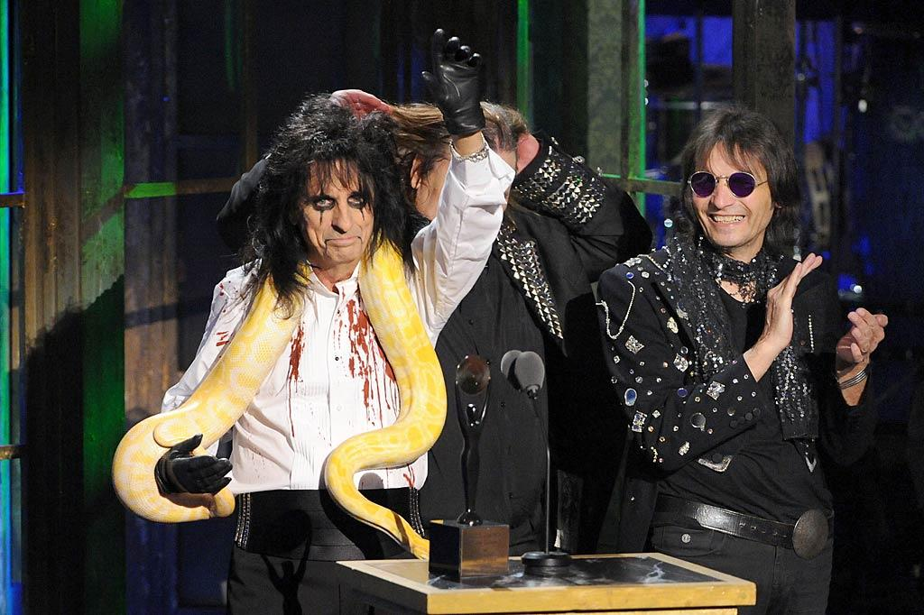 "Never one to blend into the background, Cooper brought a few friends with him -- both human and reptile -- on stage to accept his award, including fellow members of the Alice Cooper Band. Jeff Kravitz/<a href=""http://www.filmmagic.com/"" target=""new"">FilmMagic.com</a> - March 14, 2011"
