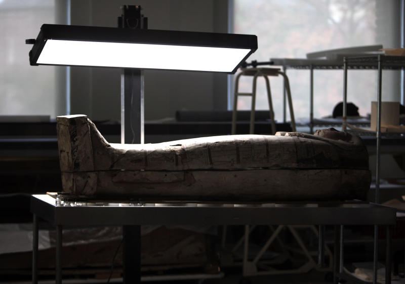 In this photo taken Friday, Oct. 19, 2012, a wooden sarcophagus is shown at the Penn Museum in Philadelphia. The newly installed Artifact Lab at the Penn Museum allows visitors to peek behind the scenes as staff members preserve relics from ancient Egypt. Human and animal mummies, as well as an intricately inscribed coffin, are among the items currently undergoing treatment and repair. (AP Photo/Jacqueline Larma)