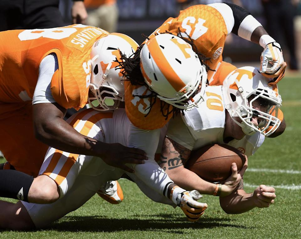 Riley Ferguson (10) is stopped during the Orange and White game during his Tennessee days in 2014. (AP file photo)