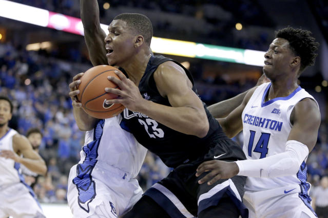 Creighton's DamienJefferson, left rear, and KalebJoseph (14) trap Gonzaga's Zach Norvell Jr. (23) during the second half of an NCAA college basketball game in Omaha, Neb., Saturday, Dec. 1, 2018. Gonzaga won 103-92. (AP Photo/Nati Harnik)
