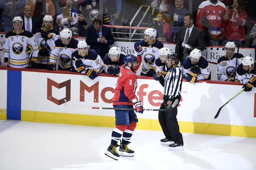 Washington Capitals left wing Alex Ovechkin (8), of Russia, celebrates his goal during a shootout of an NHL hockey game as he skates by the Buffalo Sabres bench, Saturday, Dec. 15, 2018, in Washington. (AP Photo/Nick Wass)