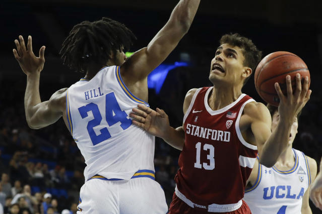 Stanford forward Oscar da Silva shoots around UCLA forward Jalen Hill during the first half of an NCAA college basketball game in Los Angeles, Wednesday, Jan. 15, 2020. (AP Photo/Chris Carlson)