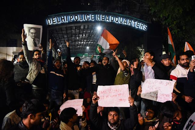 Demonstrators shout slogans outside the Delhi Police Headquarters to protest following alleged clashes between student groups at Jawaharlal Nehru University (JNU) in New Delhi on January 5, 2020. - At least 23 people were hurt at a prestigious Indian university on January 5 in what police said were clashes between rival student groups. The incident at JNU is the latest in a series of violent clashes and protests at different Indian universities in the last few weeks, with many student activists and opposition demonstrating against Modi government's controversial new citizenship law. (Photo by STR / AFP) (Photo by STR/AFP via Getty Images)