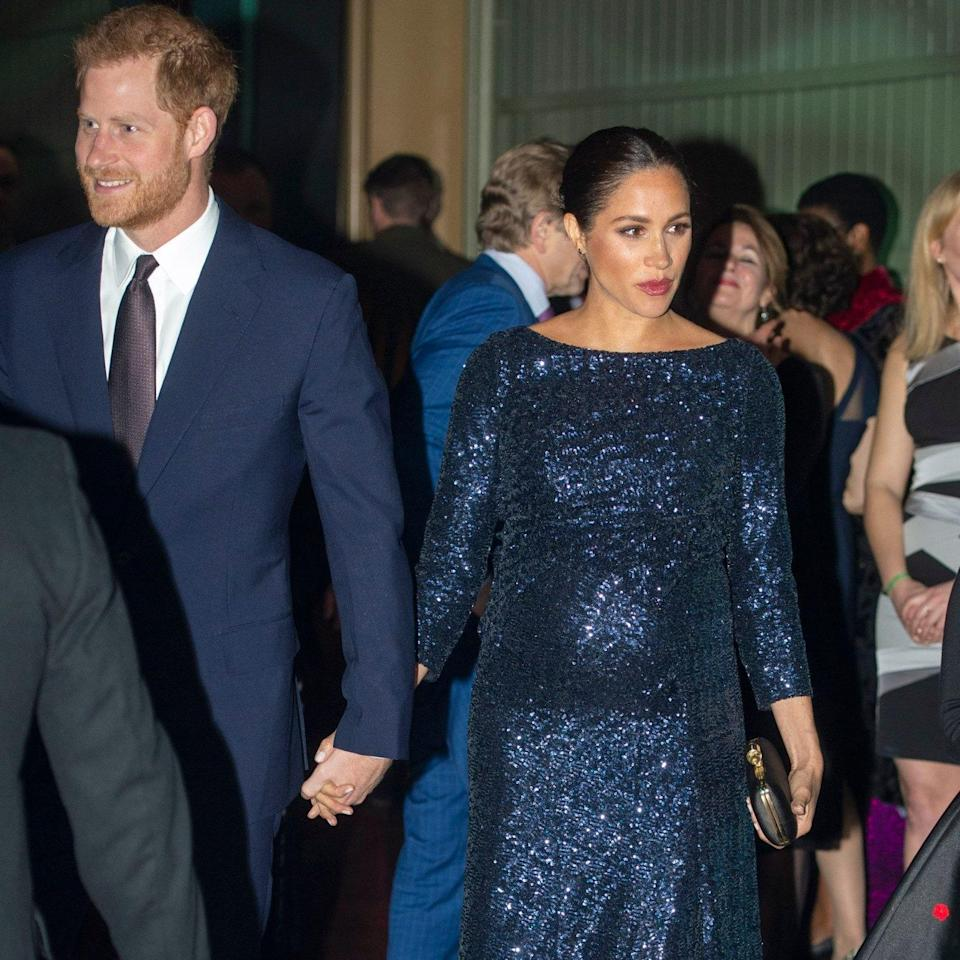 The Duke and Duchess of Sussex hold hands as they attend the event at the Royal Albert Hall - Paul Grover for the Telegraph