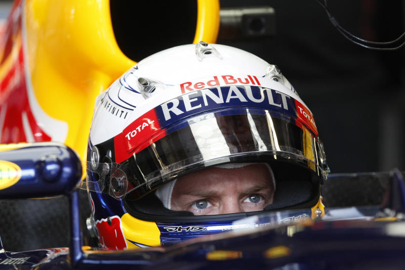 Red Bull driver Sebastian Vettel of Germany looks on in the pit during the third practice session at the Monaco racetrack, in Monaco, Saturday, May 26, 2012. The Formula one race will be held on Sunday. (AP Photo/Claude Paris)