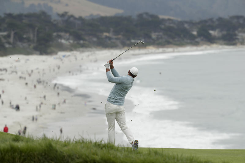 Brooks Koepka hits from the fairway on the ninth hole during the final round of the U.S. Open Championship golf tournament Sunday, June 16, 2019, in Pebble Beach, Calif. (AP Photo/Matt York)