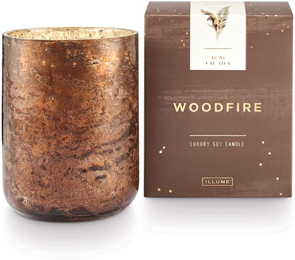 """<h2>Illume Woodfire Candle</h2><br>Reviewers claim that this """"seductive cedarwood and smoke accords"""" candle is """"almost like having a fireplace!"""" With one enthusiast, in particular, raving """"If you love the smell of a real wood fire, then you'll love this candle. It burns evenly too. My favorite candle for winter."""" Other scent notes worth mentioning are """"heady"""" patchouli leaves and """"warm"""" vanilla that, apparently, """"kindle the ultimate fireside fragrance.""""<br><br><br><strong>Illume</strong> Woodfire Mercury Glass, 9 oz Candle, Demi, $, available at <a href=""""https://amzn.to/3p2NZwS"""" rel=""""nofollow noopener"""" target=""""_blank"""" data-ylk=""""slk:Amazon"""" class=""""link rapid-noclick-resp"""">Amazon</a>"""