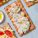 <p>A crisp whole-grain cracker gets the freshest topping of light tuna, lemony Greek yogurt, and a bright dill garnish. It's the quick snack that's almost a meal when you're having too much fun in the sun to stop and cook.</p>