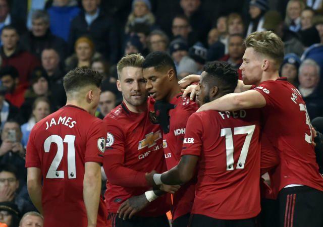 Manchester United's Marcus Rashford, center, celebrates with teammates after scoring his side's opening goal from the penalty spot during the English Premier League soccer match between Manchester City and Manchester United at Etihad stadium in Manchester, England, Saturday, Dec. 7, 2019. (AP Photo/Rui Vieira)