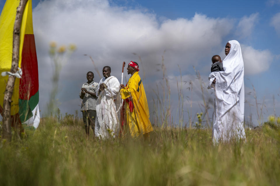 Apostolic Pentecostals celebrate Easter in field in the Johannesburg township of Soweto Sunday April 4, 2021. Such South African independent church consist of small groups of worshippers mixing African traditions and bible study. (AP Photo/Jerome Delay)
