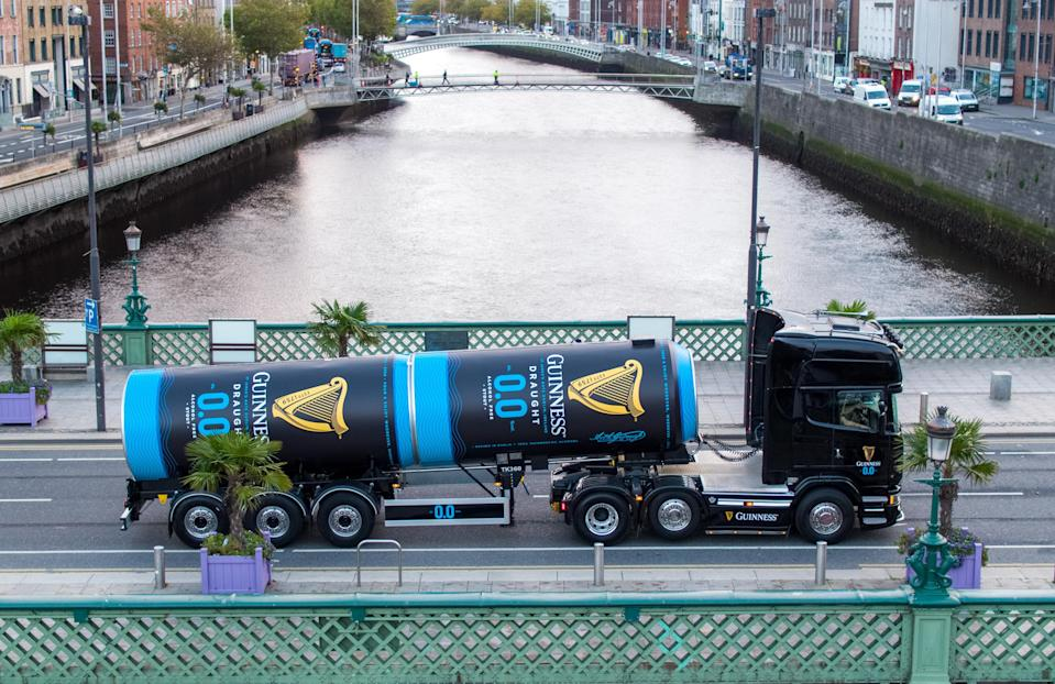 A Guinness tanker filled with alcohol-free stout crosses a Dublin bridge after leaving the St James's Gate brewery (Aerial Photography Ireland/Andres Poveda/PA)