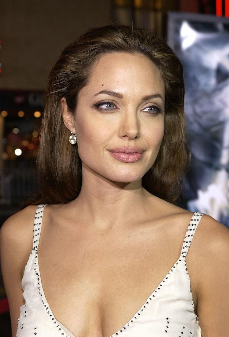Long, pulled back hair and a smokey eye have become her signature look. Angelina Jolie at the premiere of Sky Captain and the World of Tomorrow in Hollywood, California, September 2004. Photo by Getty Images.