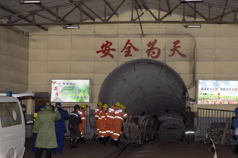 In this photo released by China's Xinhua News Agency, rescuers enter a coal mine that was the site of a gas explosion in Pingyao county in northern China's Shanxi Province, Tuesday, Nov. 19, 2019. Authorities in northern China say more than a dozen people were killed and others injured in a gas explosion inside a coal mine on Monday afternoon. (Yang Chenguang/Xinhua via AP)