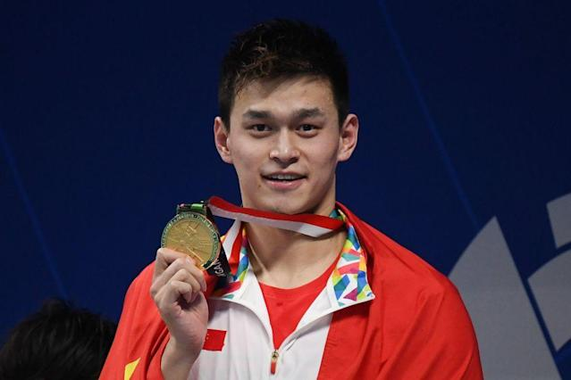 Sun Yang celebrated his medal, and his anthem. (Getty)