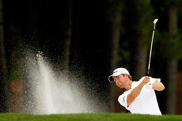 CHARLOTTE, NC - MAY 06: Webb Simpson of the United States hits an approach shot from a bunker on the first hole during the final round of the Wells Fargo Championship at the Quail Hollow Club on May 6, 2012 in Charlotte, North Carolina. (Photo by Streeter Lecka/Getty Images)