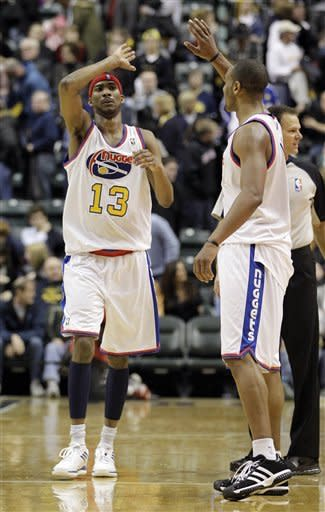 Denver Nuggets' Corey Brewer (13) and Arron Afflalo react after defeating the Indiana Pacers 113-109 in an NBA basketball game on Saturday, Feb. 11, 2012, in Indianapolis. (AP Photo/Darron Cummings)