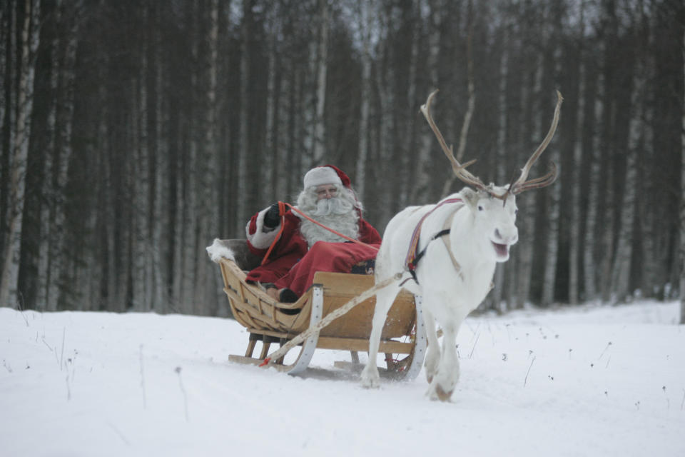 A man dressed as Santa Claus rides his sleigh as he prepares for Christmas on the Arctic Circle in Rovaniemi, northern Finland, December 19,2007. REUTERS/KACPER PEMPEL (FINLAND)   BEST QUALITY AVAILABLE