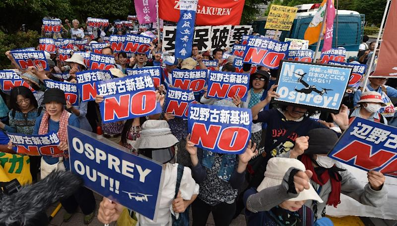 Demonstrators stage a rally in Tokyo to protest a controversial US airbase on Okinawa island in southern Japan, in May 2015 (AFP Photo/Kazuhiro Nogi)