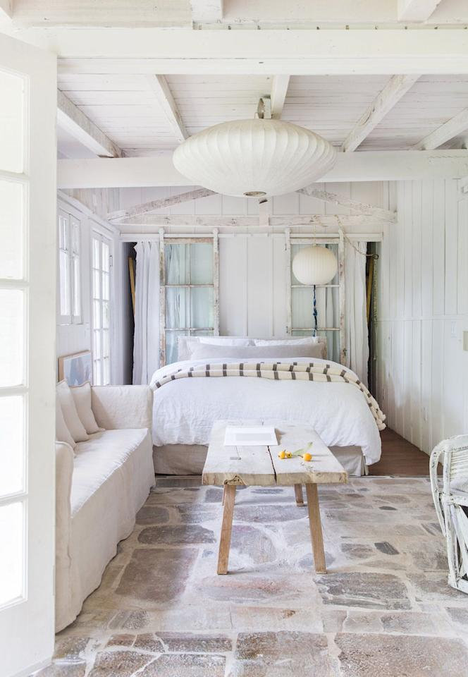 """<p>Designed by <a href=""""https://leanneford.com/"""" target=""""_blank"""">Leanne Ford Interiors</a>, this studio fuses the best of shabby chic, Wabi-Sabi, and contemporary styles. The rice paper pendant lights are both affordable and on-trend while the loose French linen slipcovers and exposed materials dipped in white create a cohesive, lived-in, and classic whole. <br></p><p></p><p><em>Check out <a href=""""https://www.hayneedle.com/"""" target=""""_blank"""">Hayneedle</a> for shabby chic bedroom finds, and shop our pick below: </em></p><p></p><p><a class=""""body-btn-link"""" href=""""https://go.redirectingat.com?id=74968X1596630&url=https%3A%2F%2Fwww.hayneedle.com%2Fproduct%2Fboltonfurniturecountrycottagecoffeetable.cfm&sref=http%3A%2F%2Fwww.housebeautiful.com%2Froom-decorating%2Fbedrooms%2Fg27196485%2Fshabby-chic-bedroom-ideas%2F"""" target=""""_blank"""">BUY NOW</a> <strong><em>Alaterre Country Cottage Coffee Table, $231</em></strong></p>"""