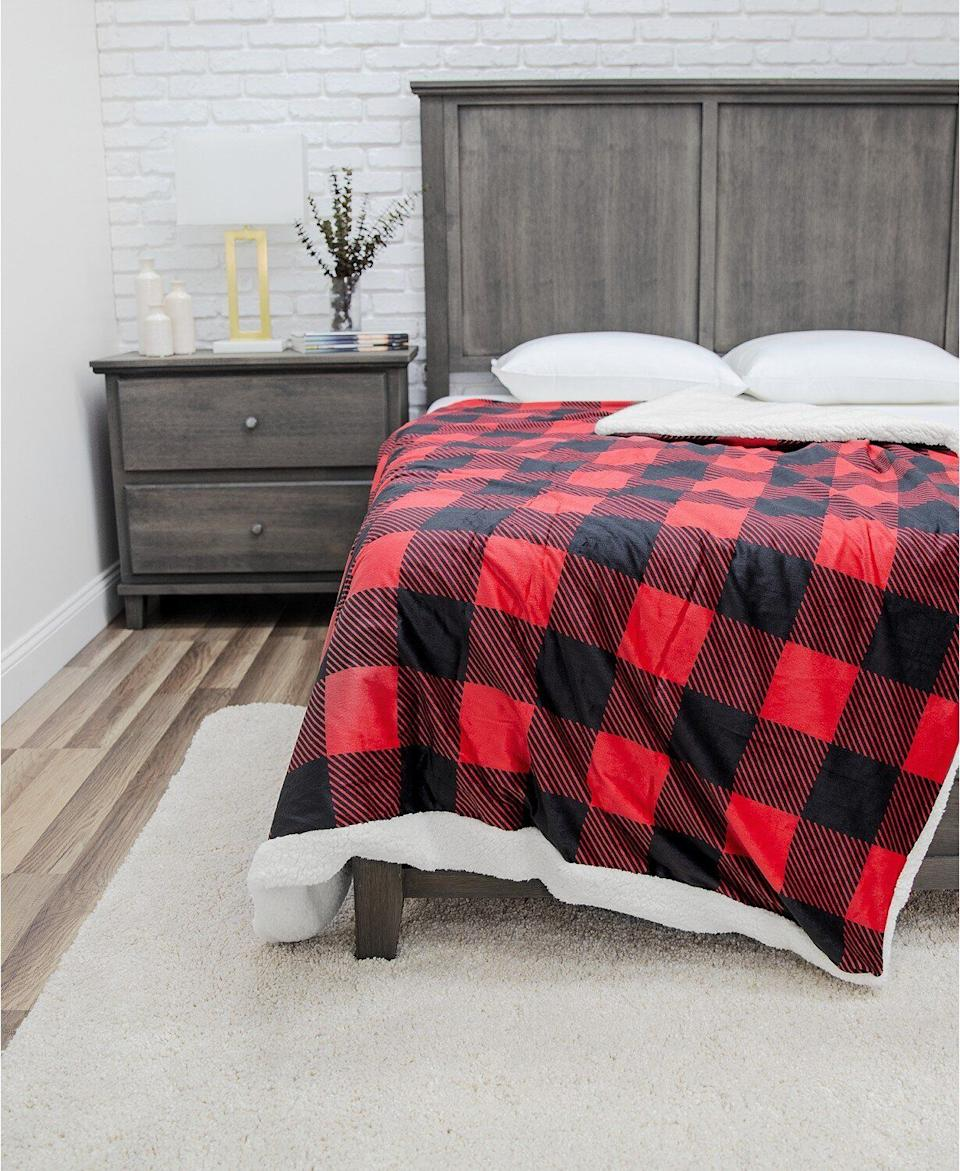 """With a flannel-like cover and sherpa inside, this weighted blanket is perfect for winter. It has a removable cover that's machine washable. <a href=""""https://fave.co/2GYW95R"""" target=""""_blank"""" rel=""""noopener noreferrer"""">Originally $260, get it now for $56 with code <strong>THANKYOU</strong> at Macy's</a>."""