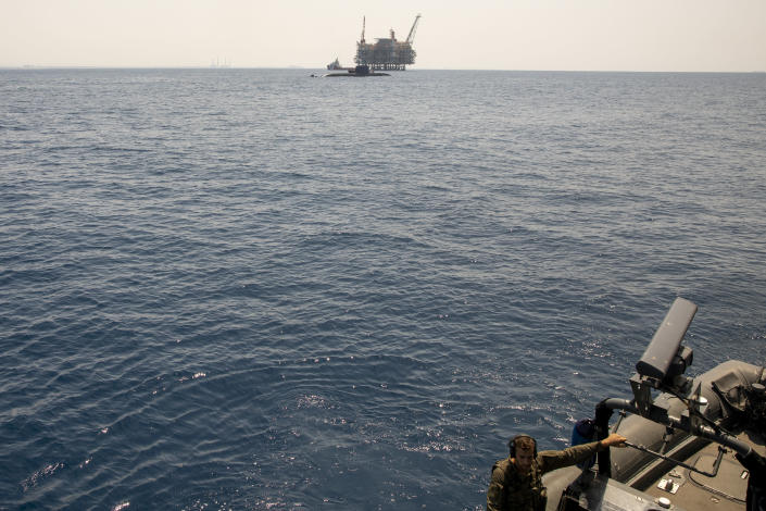 Israel's offshore Leviathan gas field is seen from on board the Israeli Navy Ship Atzmaut as a submarine patrols, in the Mediterranean Sea, Wednesday, Sept. 1, 2021. Speaking to The Associated Press days after completing his five-year term, Sharvit described Iranian activities on the high seas as a top Israeli concern and said the navy is able to strike wherever necessary to protect the country's economic and security interests. (AP Photo/Ariel Schalit)
