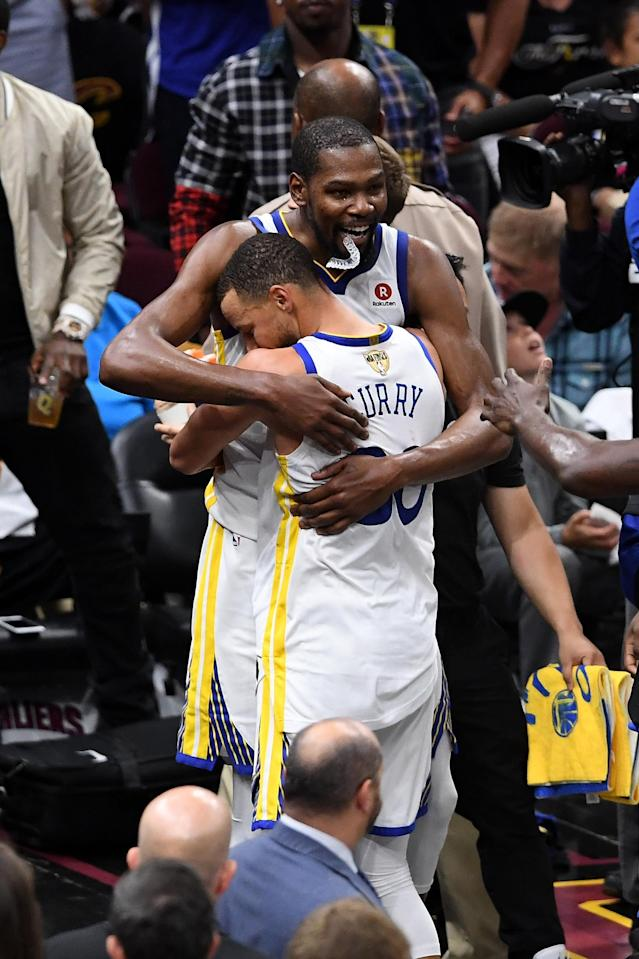 CLEVELAND, OH - JUNE 08: Stephen Curry #30 and Kevin Durant #35 of the Golden State Warriors celebrate late in the game against the Cleveland Cavaliers during Game Four of the 2018 NBA Finals at Quicken Loans Arena on June 8, 2018 in Cleveland, Ohio. (Photo by Jason Miller/Getty Images)