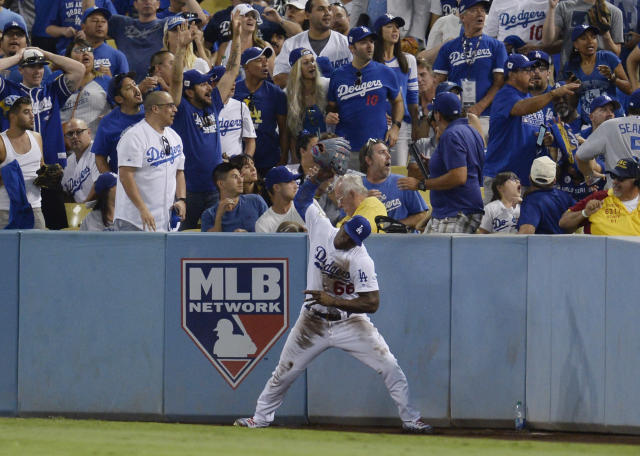<p>Los Angeles Dodgers right fielder Yasiel Puig throws his glove after failing to catch a ball hit for a ground-rule double by Houston Astros third baseman Alex Bregman (not pictured) in the 8th inning in game two of the 2017 World Series at Dodger Stadium. Mandatory Credit: Gary A. Vasquez-USA TODAY Sports </p>