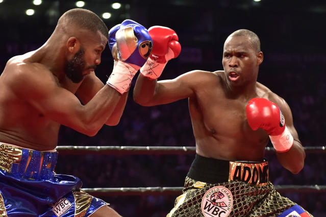 Adonis Stevenson, right, and Badou Jack exchange blows during the first round of the WBC light heavyweight championship boxing match in Toronto on Saturday, May 19, 2018. (Frank Gunn/The Canadian Press via AP)