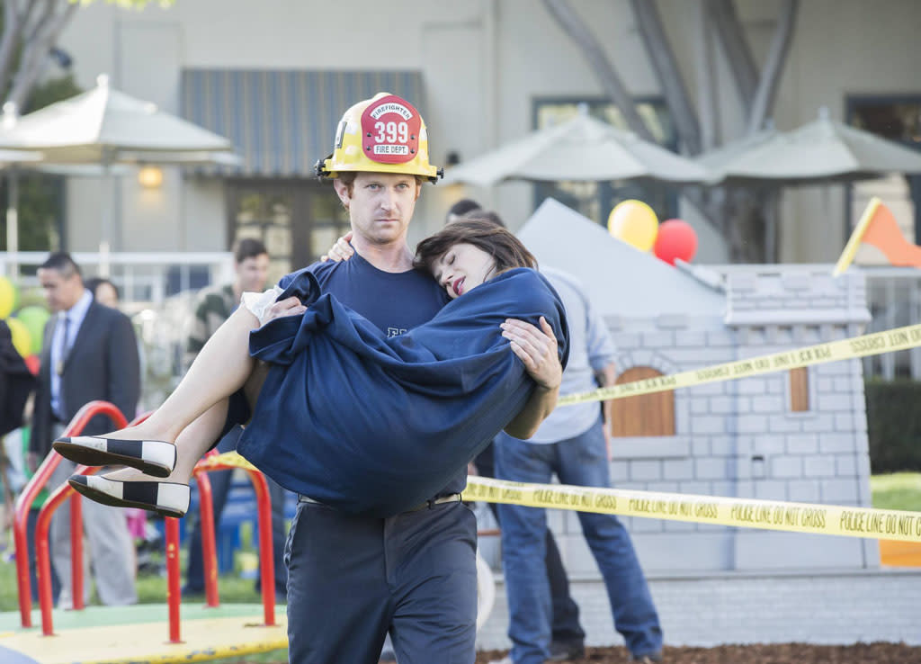 "Jess (Zooey Deschanel) is rescued by a fireman (guest star Christopher Wallinger) in the ""Virgins"" episode of ""New Girl."""
