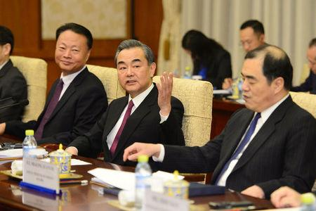Chinese Foreign Minster and State Counselor Wang Yi, second from left, attends a meeting with Philippine Foreign Affairs Secretary Alan Peter Cayetano at the Diaoyutai State Guesthouse in Beijing, China March 21, 2018. Parker Song/Pool via REUTERS