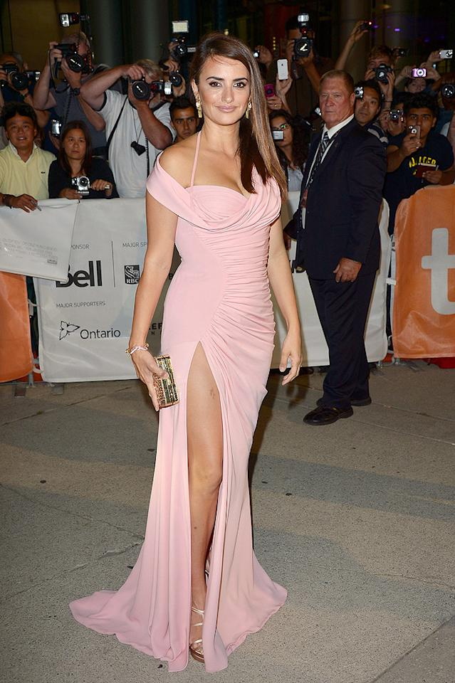 "Nobody wears Versace quite like Penelope Cruz. Late last week, the Spanish siren showed off her toned stems and sensational sense of style when she showed up at the Toronto International Film Festival premiere of <a target=""_blank"" href=""http://movies.yahoo.com/movie/venuto-al-mondo/"">""Twice Born""</a> in this breathtaking, blush-colored vintage piece, Swarovski bracelet, and strappy gold sandals. It doesn't get much better than this! (9/13/2012)<br><br><a target=""_blank"" href=""http://omg.yahoo.com/news/penelope-cruz-tom-cruise-split-she-rejected-scientology-204500001.html"">Why did Cruz split with Cruise?</a>"