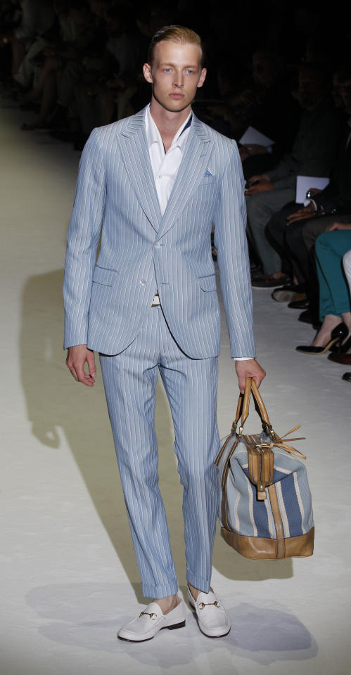 A model wears a creation of Gucci, from the men's Spring-Summer 2013 collection, part of the Milan Fashion Week, unveiled in Milan, Italy, Monday, June 25, 2012. (AP Photo/Luca Bruno)