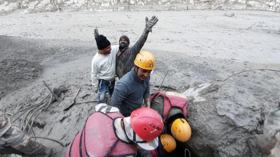 This photo provided by Indo Tibetan Border Police (ITBP) shows a man reacting after he was pulled out from beneath the ground during rescue efforts: Source: AP