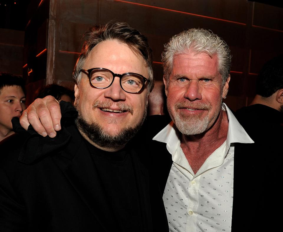 "LOS ANGELES, CA - JULY 09:  Director Guillermo del Toro (L) and actor Ron Perlman pose at the after party for the premiere of Warner Bros. Pictures and Legendary Pictures' ""Pacific Rim"" at Hollywood and Highland on July 9, 2013 in Los Angeles, California.  (Photo by Kevin Winter/Getty Images)"
